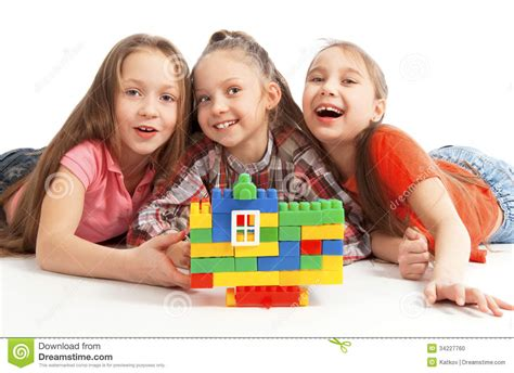 Children Playing A Toy House Stock Photo - Image of